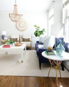 Spring decorating ideas in a classic living room with neutral base pieces and a variety of blue accents.