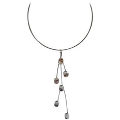 Bent Knudsen Sterling Silver Danish Modern Necklace | From a unique collection of vintage drop necklaces at https://www.1stdibs.com/jewelry/necklaces/drop-necklaces/