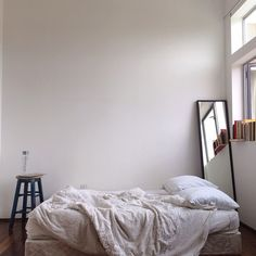 I love the bedding and the floor mirror. Also, the white+wood combo.