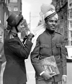 Eva Burrows straightening the puggaree worn by a fellow delegate at the Salvation Army's first international youth congress in London in 1950