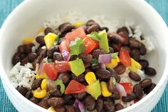 Serve this delicious vegetarian black bean rice bowl with lime wedges to squeeze over top. Photo by Ryan Brook.