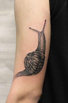 Snail Tattoo by Iñaki Beaskoa at Siha Tattoo