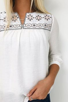 I like the detailing at the top of this blouse. Would love something like this in any color.