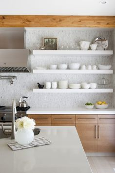 Alice Lane Home Collection | Mosaic tile with white open shelves.