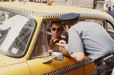 The definitive film starring a New York taxi - Taxi Driver, with Robert De Niro, directed by Martin Scorcese and released in 1976.