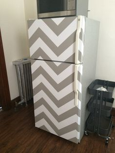 Turn an old white fridge into a statement with Target's new line of contact paper/temporary wallpaper! Variety of colors and designs!