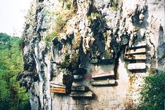 The hanging coffins of Sagada (Phillipines). This 'burial' method is still an option today.