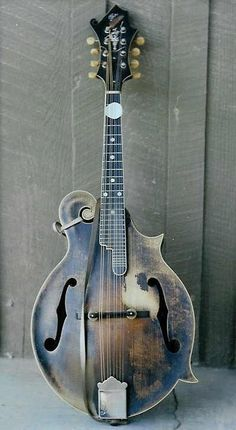Bill Monroe's well worn F-style mandolin, scratched out Gibson LOGO