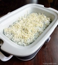 Warm and cheesy spinach artichoke dip is a perfect and popular appetizer for a party! It can be made in a slow cooker or in the oven and it's great either way!