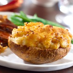 Simple Stuffed Potatoes: A treat for holiday meals if you're looking for a change from mashed potatoes. #cheese #potatoes #holidays
