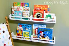 Love these cheap IKEA spice rack bookshelves! Perfect for those sweet little baby books!