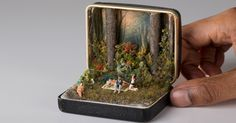 These are old ring boxes from jewelers, not Altoids tins, but the idea transfers well enough.  Little vintage historically accurate dioramas, as well as some fanciful things, like a wedding on the moon .