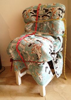 Roos Soetekouw - Sleepingchair #4, woven fabric with design inspired by an old mattress, wrapped around an old chair with hand twisted cords.