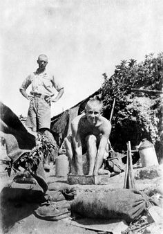 Gallipoli, WW1. A bath in a pint of water near Pope's Hill. All water had to be carried up into the front-line positions from the beach or from water tanks closer by to which it had been pumped. For those who could not get down to bathe regularly on the beaches this was the only way to keep clean.