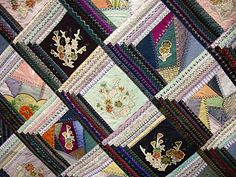 Japanese corner-square Log Cabin quilt with narrow logs on two adjacent sides. Crazy quilt for corner squares, complete with embroidery. Looks dimensional because of the black and white logs. Lovely effect!