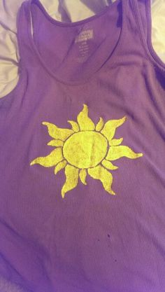 Upcycle an old tank top by adding the sun design from tangled Rapunzel Disney diy shirt