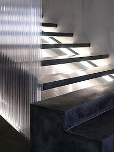 gus wüstemann - it's the total contrast of the raw concrete and polycarbonate panels - to dematerialize the stairs and to solve the need of a banister we packed the whole staircase in a translucent and light up volume of polycarbonate. Interior Stairs, Interior Architecture, Interior And Exterior, Interior Design, Metal Stairs, Modern Stairs, Terrazzo, Types Of Stairs, Black And White Interior