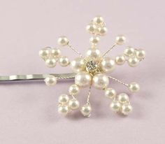 The Pearl Snowflake hairgrip is perfect for a midwinter wedding, made with swarovski pearls of various sizes and sparkly diamante, designed with both brides and bridesmaids in mind.