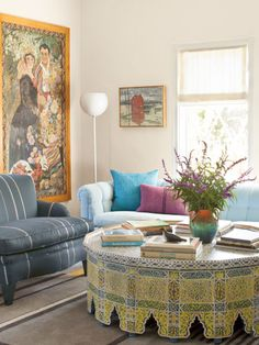 A painted-wood Moroccan table strikes an exotic note in this #livingroom.