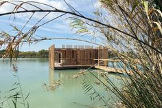 Completed in 2017 in Sorgues, France. Images by Marco Lavit Nicora. The Eco-hotel is located in a fishing reserve in Avignon, France. The 10 suites evoke primitive buildings on the shore of the lake; floating on the. Floating Architecture, Tropical Architecture, Prefab Buildings, Wooden Buildings, Aix En Provence, Prefabricated Cabins, Hotels In France, Floating Hotel, Chateauneuf Du Pape