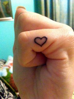 Tiny heart tattoo