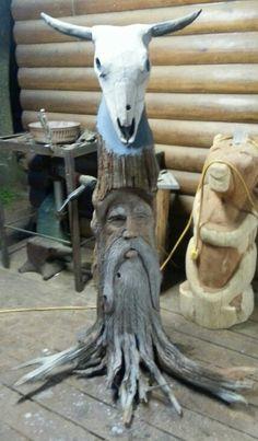 Cedar stump carved by William McKinney. All one pc horns added.