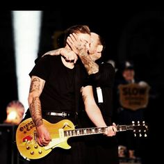Julian and Mike Ness in for a smooch at the end of Ball and Chain