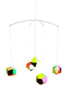 """Themis Mobile just $29.95 & free shipping  A delicate, geometric décor sculpture composed of five faceted ornaments, each with its own distinct palette of color: fluorescent neons, purples and browns. As designer Clara von Zweigbergk was inspired by the geometric design of polyedra, """"the shapes quickly came together as a mobile. I think of them as planets and like to see the colors change while gently turning.""""   Click to read more!"""
