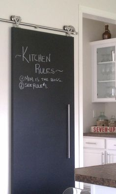 Here's another shot of our barn door in the kitchen utilizing the chalkboard paint.  I love this.  For 325$ for the hardware and 23$ for the hollow core door, and 18$ for a quart of chalkboard paint, here you go.  Big payoff!