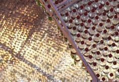 The cola-bow by PENDA    is a public art installation made out of more than 17.000 recycled plastic bottles, which were braided to create a shape inspired by the swings of the Coca-Cola logo.  The bottles were collected by a joint initiative of universities around Beijing and Coca-Cola China to give citizens a bottle of Coke for every 10 empty ones brought back to a recycling spot. The amount of collected plastic bottles ended up in an entrance conopy to the Student Beijing Design…