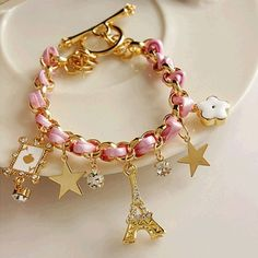 ✨2 left✨ Adorable pink Eiffel Tower charm bracelet  Super cute charm bracelet includes an adorable Eiffel Tower, cute stars, rhinestones, white flower, and adorable poker ace card. Available in pink. Also available in colors black and white in my other listings.When ready to purchase please comment and I will make a separate listing for you. Jewelry Bracelets