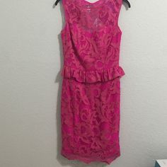 Lilly Pulitzer Kiri Dress Lilly Pulitzer Kiri dress in Mambo Pink. Worn twice, still in amazing condition! Gorgeous lace detail with peplum skirt and open back. From a smoke free environment! Lilly Pulitzer Dresses Mini