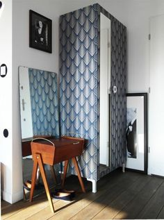 IKEA Hacks: Aga of Patchwork & Co. gave her wardrobe a makeover with some graphic wallpaper.