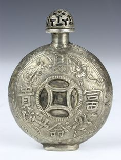 China, 19th C., silver snuff bottle of circular form decorated with auspicious symbols, with stopper. Height 3 in.