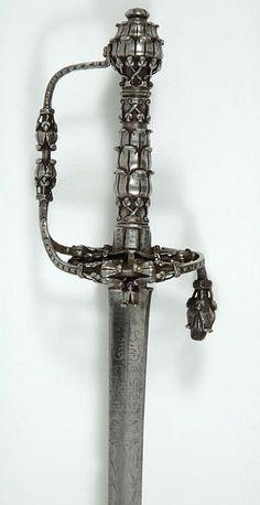 "European Backsword Dated: circa 1650 — 1660 Culture: Western European Medium: steel Measurements: overall length, 96 cm; blade length, 79.3 cm; blade width, 2.3 cm; hil length, 17.5 cm; hilt width, 11 cm Inscriptions: ""IVNTILIA NUS ROM"", ""MEFECIT SOLINGEN""; ""PARIS TRO"" and ""ENGEL LOBAG"""