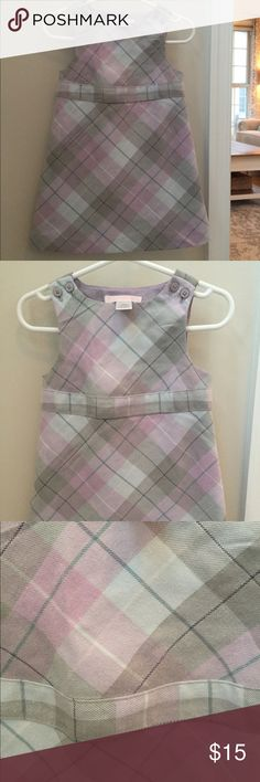 12-18 month plaid Janie and Jack winter dress. 12-18 month plaid Janie and Jack sleeveless winter dress. The colors are more of a pastel purple, green, and blue with silver threading detail throughout. There are 4 buttons at the top of the dress that are functional for putting on/taking off. Smoke free and pet-free home. **Check out my closet for other boy and girl size newborn - 3T clothes! I am in the process of selling off all of my boy/girl twins' clothes! Happy Poshing! ;) Janie and…