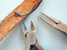 How to attach a metal-stamped bracelet blank to a leather cuff using waxed linen cord.