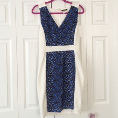White and blue patterned dress Nikibiki brand size large. Blue pattern design and white textured material. Fitted And stretchy. Deep v front and a hidden zipper on back. Never worn!!!! Dresses