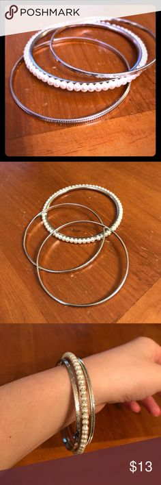 🆕3 Set Silver Bangles 🆕3 Set Silver Bangles. This piece is so ELEGANT! The subtle small silver bangles make the pearl bangle pop! NWOT, never worn! Excellent condition! This piece is my favorite. Get this today! 😍😍 Jewelry Bracelets