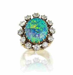 An opal and diamond cluster ring, circa 1930.