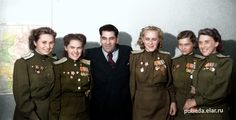 Female pilots of the Aviation Regiment E. D. Bershanskaya after the award of the Committee of Soviet Women, among those present the Heroes of the Soviet Union R. S. Gasheva (2nd left), E. A. Zhigulenko, I. F. Sebrova and photographer Ya.N.Halip (3rd from left).