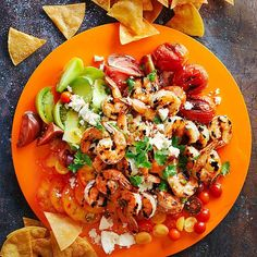 Grilled tequilla-infused shrimp top these light nachos. More healthy Mexican recipes: http://www.bhg.com/recipes/ethnic-food/mexican/heart-healthy-mexican-recipes/?socsrc=bhpgin041513tequillashrimpnachos