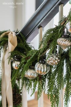 Classic Christmas Home. Staircase greenery, Mercury ornaments and silk ribbon bring the holidays right home.