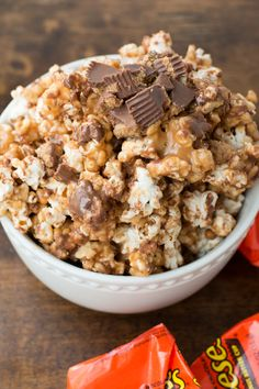Reeses Krispies Popcorn (Peanut Butter, Karo Syrup, Sugar, Popcorn Kernals, Salt, Rice Krispies Cereal, Chocolate Chips & Reeses Peanut Butter Cups.)   l  Oh Sweet Basil.com