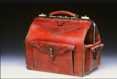 A hand-carved leather, old-school doctor's bag