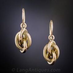 Antique Knot Motif Earrings: Lightly and lovingly crafted in 10K two-tone rose and yellow gold at the-turn-of-the-last-century, a delightful pair of interlinking loops or 'love knot' earrings. Sweet.