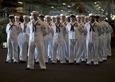Chief Petty Officer selectees stand at parade rest during a ceremony  commemorating the Sept. 11, 2001, attack. #americasnavy #usnavy navy.com
