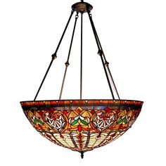 Grand and eye catching, this Tiffany-style chandelier features rich hues of ivory, green and red. The repeating geometric shapes and bronze finish add interest to this lighting fixture.