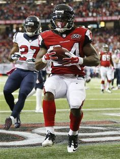 Atlanta Falcons running back Devonta Freeman (24) runs into the end zone against Houston Texans strong safety Quintin Demps (27) for a touchdown during the first half of an NFL football game, Sunday, Oct. 4, 2015, in Atlanta. (AP Photo/John Bazemore) - Texans Falcons Football