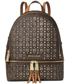 Carry an eye-catching signature style with the Rhea backpack by Michael Michael Kors, featuring distinctive perforated details. | MK signature PVC; lining: polyester | Imported | Medium sized bag; 13""